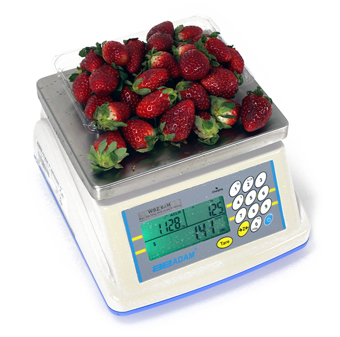 Retail Scale Covered In Strawberries